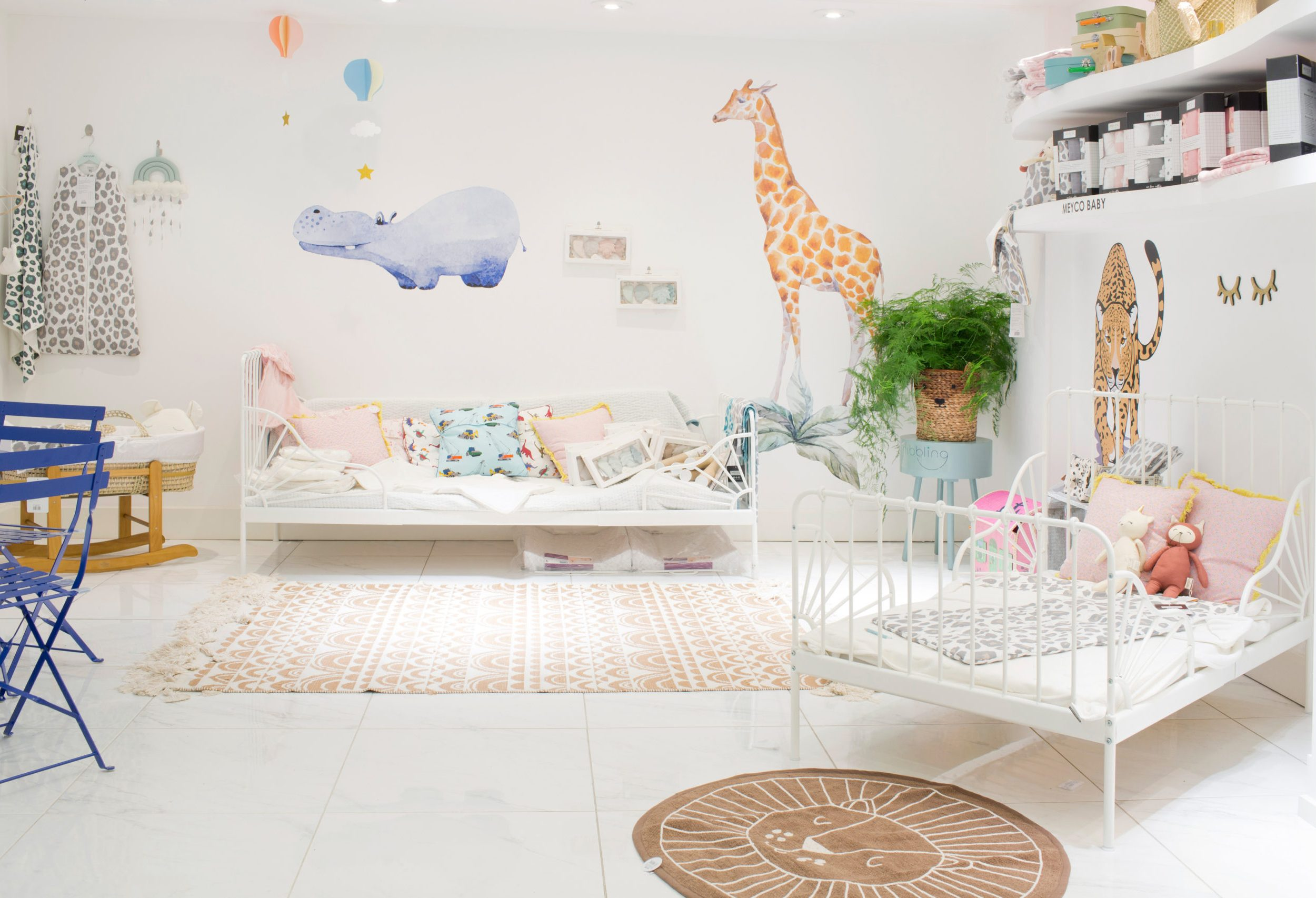 Children's bedroom furniture and wall art of hippo and giraffe