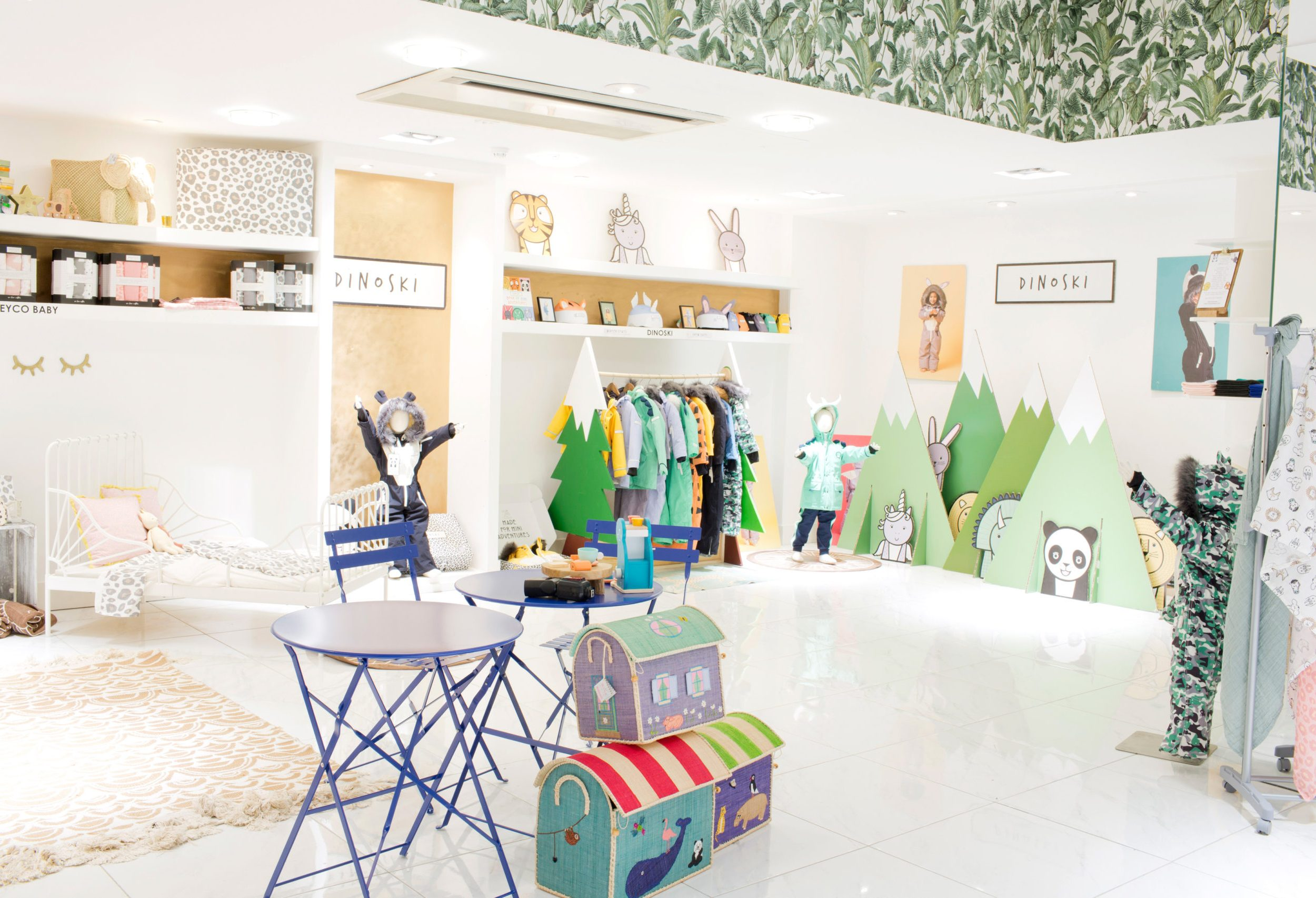Interior of children's shop with table and chairs and products